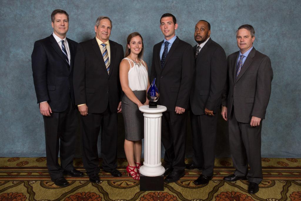 Courtney Zalesak, HR Director (left center) Daryll Zalesak, General Manager (right center).